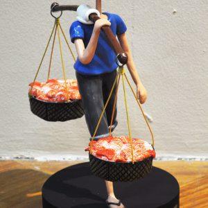 Code: 19710 Title: Fish Vendor Size: 16x14x8in Medium: Sculpture