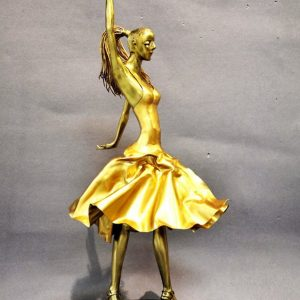 Title: Flamenco Dancer Size: L 8in x W 10 in x H 22in  Medium: Brass on black wood base  Code: 20882