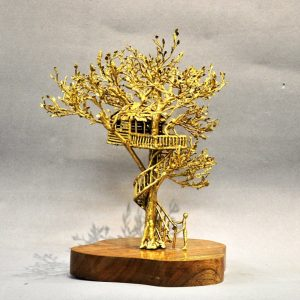 Code: 21102 Title: Treehouse  Size: L 8 in x W 9.5 in x H 14 in Medium: Brass on natural wood base